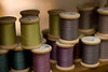 """Spools of thread adorn the shelf of a quilt shop in Summerville, South Carolina. Today, American quilt making is a craft of leisure rather than of pioneering necessity, but quilters and the boutique owners that cater to them are passionate about creating """"comfortable"""" artwork, while keeping an old tradition alive."""