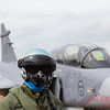 Swedish Grippen captured behind a dummy pilot in flying gear