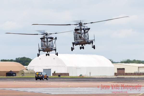The Royal Navy Black Cats display team in the hover