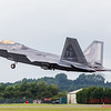 F-22A Raptor lifts it's landing gear as it exits the runway