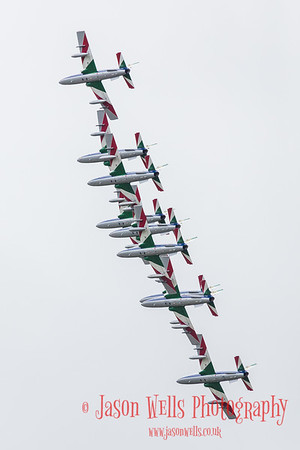 The Italian Air Force's Frecce Tricolori bank in formation