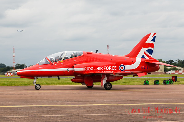 An Air Cadet waves from her back seat of a Red Arrow