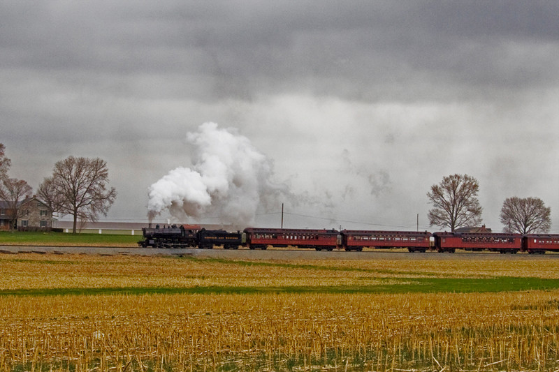 A paceing shot of 475 as she passes the harvested corn fields of a farm.