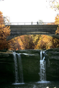 2 5OCT09  A couple of pedestrians stop to look at the West Falls of the Black River in Elyria.  Photo by Chuck Humel