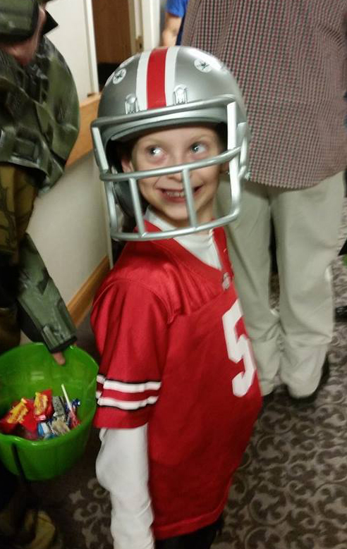 Jayce, 7, is ready to take the field as an Ohio State Buckeyes football player.