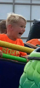Colson Lutz, 4, of Wakeman takes a ride on the dragon coaster.