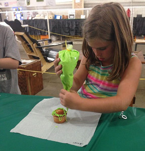 Cupcake decorating was one of the activities for children at the fair.