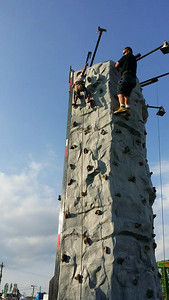 Josiah Bennett, 5, climbs the rock wall.