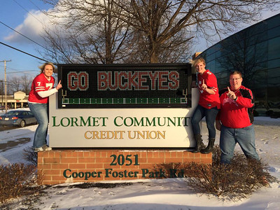 Chrissa Yuhas, Jacqueline Sergent and Scott Heidrich are rooting for the Buckeyes at LorMet Community Credit Union.