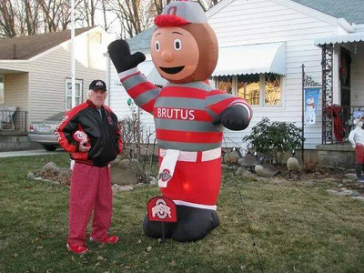 Wally Riegel poses with Brutus before Monday night's game.