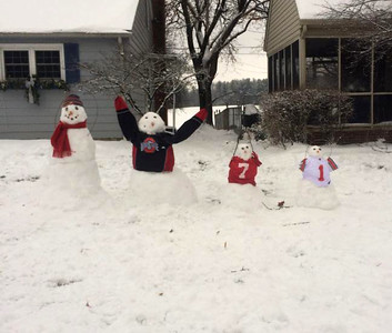 Corinne Aebersold's children took advantage of a snow day in Ashland to decorate the yard.