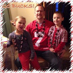 Reporter Melissa Linebrink's husband, Seth, and children Katie and Derek show off their Ohio State spirit.