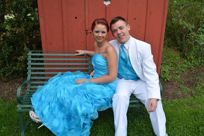 Elyria High seniors Brittany Metcalf and AC Forester pose before prom on May 10.