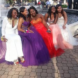 Celesta, Danya, Jasmine, Chasity and Tianna take photos before Elyria's prom.