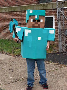 Michael Peck, 10, shows off his homemade Minecraft Steve with diamond armor costume.