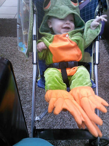Mason Hamilton, 4 months old, is staying warm in his frog costume.