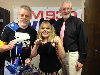 "WEOL was showing its Halloween spirit today, with Continuity Director Tom Hutchison as ""The Ghost of Formats Pas;"" Promotion Director Suzy Peters as a mean cat; and News Director/Morning Show host Craig Adams as Good & Plenty."