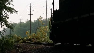 A train engine is stuck on the service tracks behind Bennett Drive after a tree fell across the tracks.