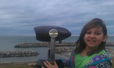 Keira Franklin, 8, of Elyria, watches the leading edge of Sunday night's storm move across Lake Erie.