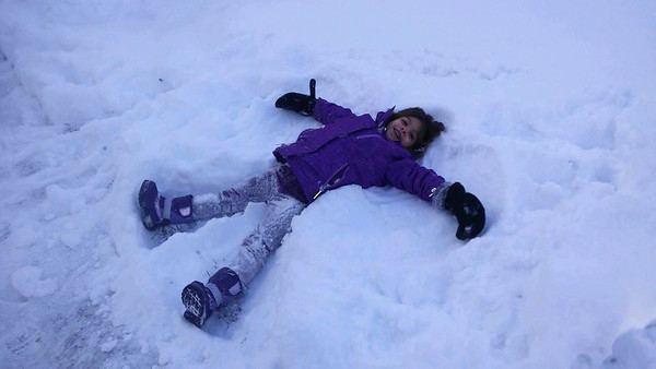 Zoe, 4, makes snow angels.