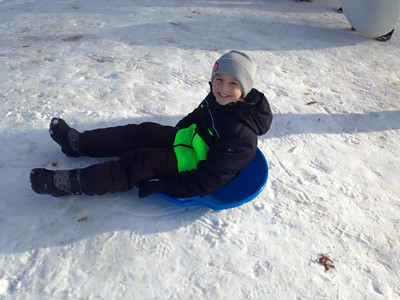Tyler, 10, readies to go down the sledding hill.