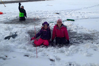 Cara, 12, Tyler, 10, and Leah, 6, enjoy the snow in Lorain