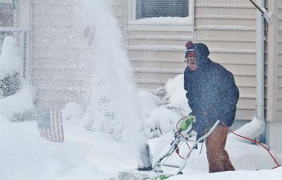 Donna Kaminski's neighbor clears his driveway on Bellfield Street.