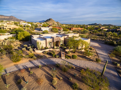 Aerial drone photo of beautiful southwest Santa Fe style residence, late afternoon, long shadows. Mesa AZ 2017