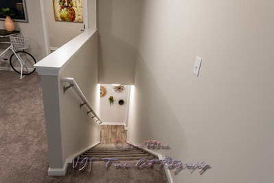 Carpeted Staircase In Modern Townhouse