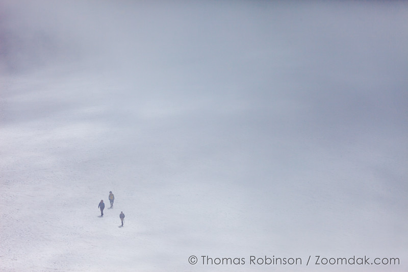 Three Hikers Climbing South Sister