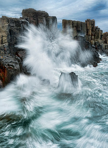 Bombo Headland Quarry, New South Wales, Australia.  Great swells from the South Pacific come ashore here and demonstrate their power when they hit the basalt columns of the former quarry.  This huge wave produced patterns like a fireworks display.  The booming sound and rhythmic movement were fascinating.