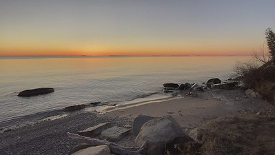 A video clip of sunrise looking across Green Bay from the upper Peninsula of Michigan.