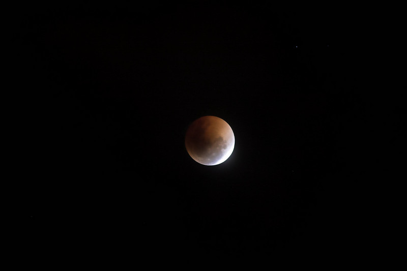 Here the moon has just passed the peak of the eclipse, and is starting to regain its full brightness.