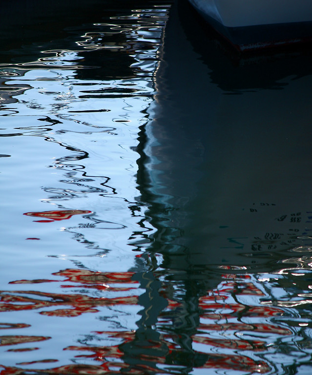 Reflection of Boat & Flags