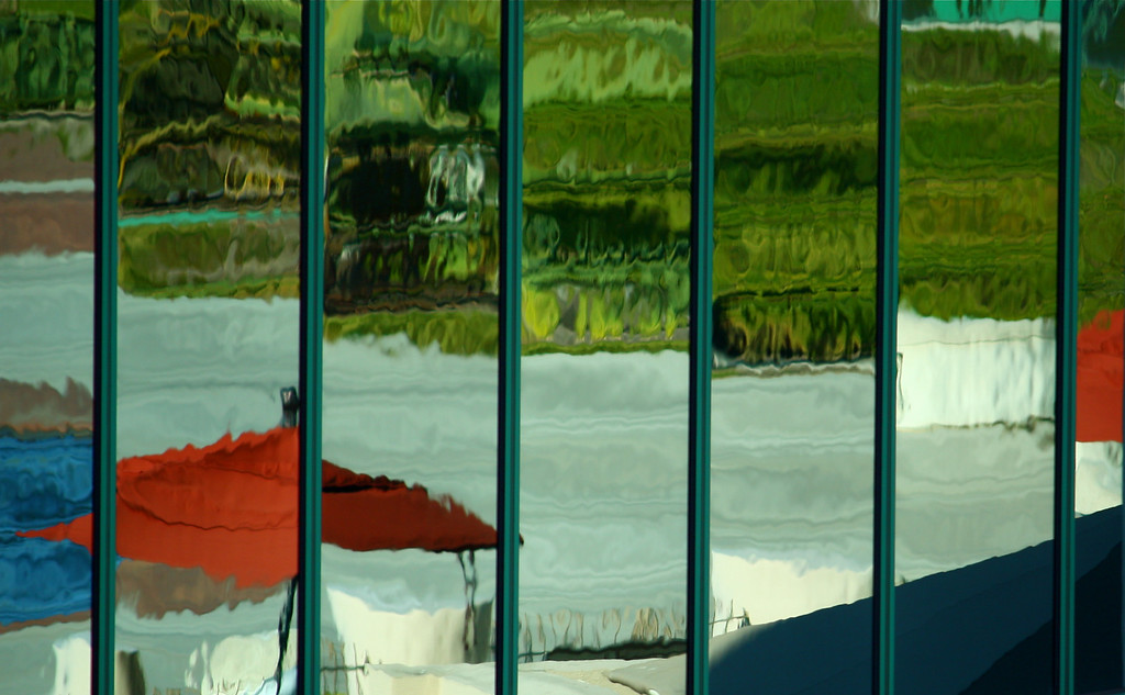 Reflection in Hotel Windows of Pool Area. This one looks like a Photoshop effect, but it's straight out of the camera with only crop and level adjustments.