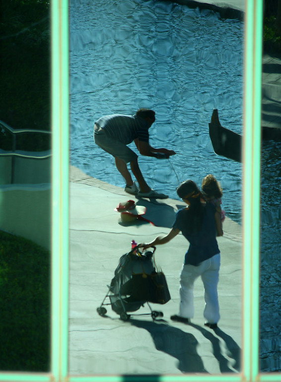 Reflection in Hotel Windows of Lakeside Activity