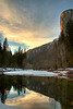 <h3>El Capitan at Sunset with the Merced River</h3>The sun is setting over the Yosemite Valley.  The Merced River is in the foreground providing that great reflection.  The color on El Capitan is from the sun just getting ready to disappear.<br><br>I continue to play with HDR with this picture.  I took 10 exposures each 1/3 EV apart.  I then used Photomatix to combine them.  I like this approach as opposed to carrying around the various filters that would be need to balance the exposure of the sky with the valley floor.