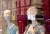 Reflection: two manikins with red drapes