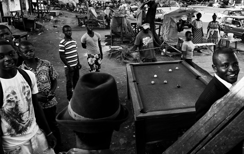 Camerun. Yaoundé. 2012. Game of pool in the center.