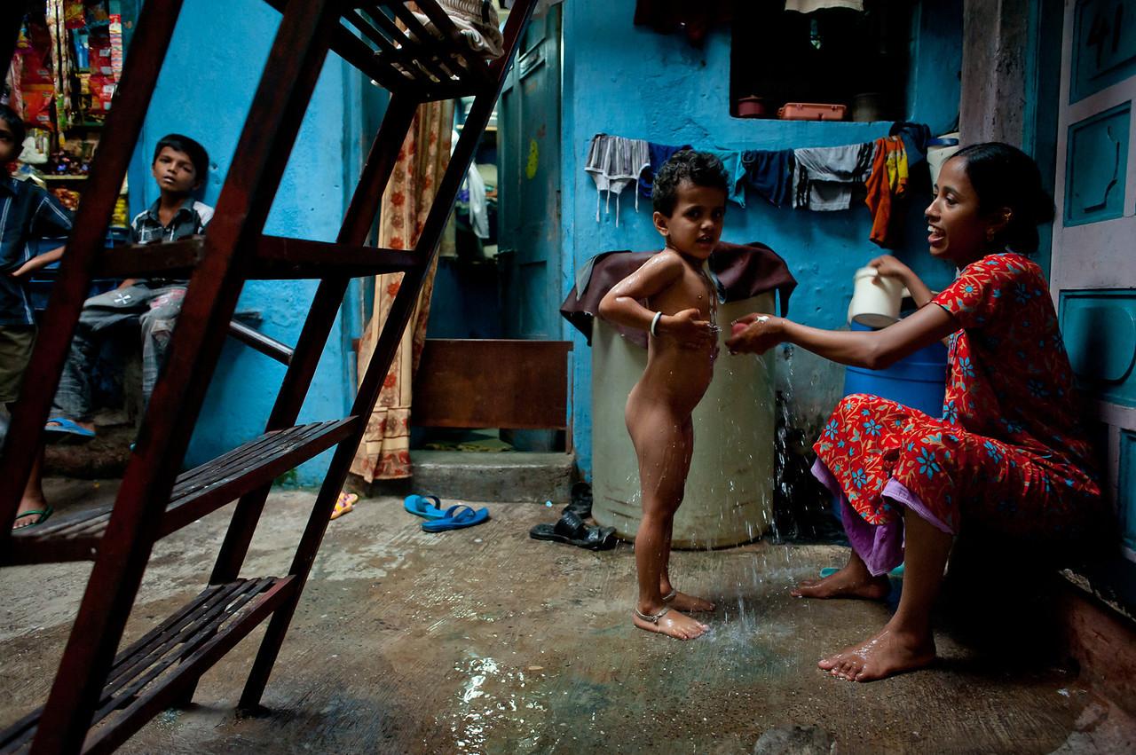 India. 2011. Mumbai. Dharavi slum. The shower.