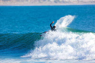 Surfing  at Rincon,USA  Date: Jan 21, 2014 Time: 07:17.PM Model: Canon EOS 7D Lens: EF70-200mm f/2.8L IS II USM