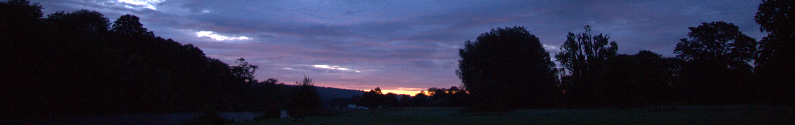 Sunrise Over Riverbank