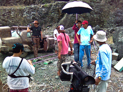 Cirio H. Santiago the director in the blue t-shirt and red cap
