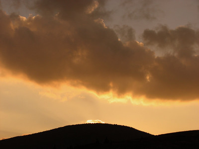 The sun sets behind Roan Mt