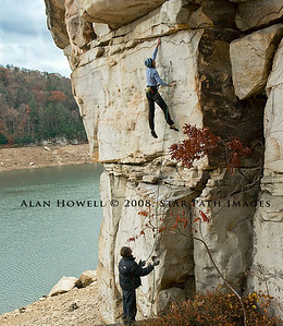 Visiting Cali climber 'Elkie' in mid flight on the crux of Surfer Rosa (5.12c), Summersville Lake WV.