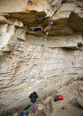 John Johnson working into the first crux of Apollo Reed, 5.13a. Coliseum Wall at Summersville Lake, WV.