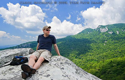 Alan enjoying a photo break on the summit of Ship Rock, located across from Lincove Viaduct on the BRP, on the flanks of Grandfather Mtn.  Photo taken by SPI freelance photographer, Carol Michaels.