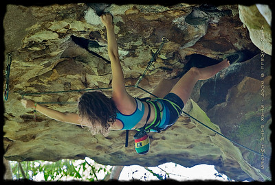 Ashley stylin' the super steep 'Solstice', 5.12a, in 92 degree summer heat at Clear Creek in TN.