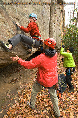 Penn climber, Melissa, pulling a low crux on the Long Wall, Summersville Lake WV.