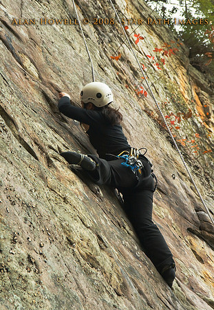 Debbie in full stem, styling a reachy crux on the Long Wall, Summersville Lake WV.